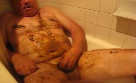 Fat man smearing poop