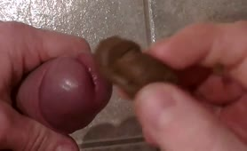 Stroking his cock with poop on it