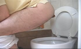 Constipated gay guy pooping big one over toilet