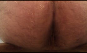 Hairy guy pooping in close up
