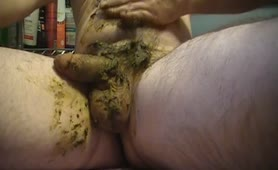 Chubby guy rubbing shit on his cock