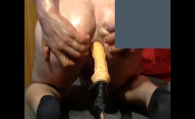 Holding his cock while riding dildo