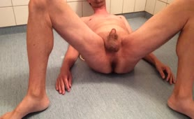 Mature man shitting again on bathroom floor