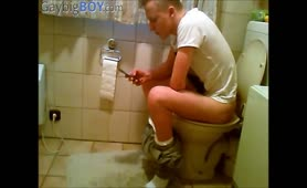 Young guy shitting in toilet