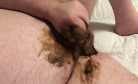 Fat guy wanking with poop