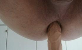 Fucking a dildo