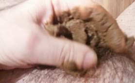 Brown crap on his cock
