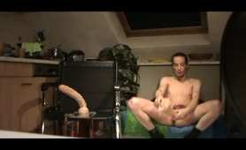 Huge dildo into his ass