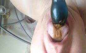 Licking a big black dildo