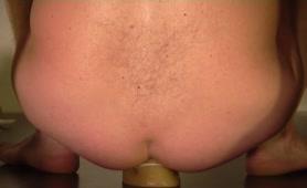 Shitting on a dildo