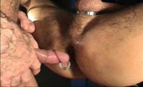 Pulling a condom from his asshole