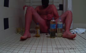 Drinking piss while stroking his cock