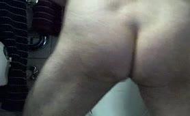 Teen boy pooping in standing position