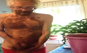 Old man jerking off hard with saved brown poop