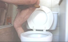 Big turd from hairy boy over toilet
