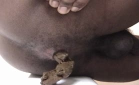 Black gay guy shitting a big pile of poop