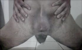 Teen boy spreading butt cheeks while pooping