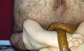 Hairy guy pooping on his feet