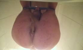 Teasing with his big ass while pooping