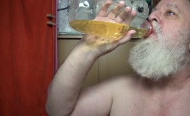 Old guy drinking his own piss