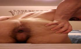 Hairy guy shitting on a wooden table