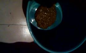 Liquid shit in a plastic bucket