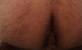 Hairy dude pooping in close up