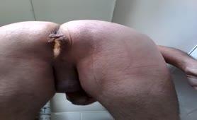 Fat guy shitting in bathtub
