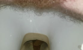 Hairy dude shitting in close up
