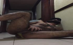 Tattooed guy pooping on bedroom floor