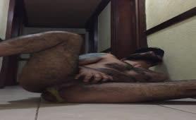 Tattooed guy pooping on bedroom floor