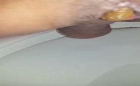 Teen boy shitting in toilet