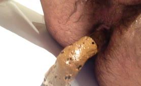 Hairy guy shitting in shower