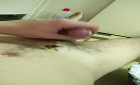 Hairy dude jerking off with scat