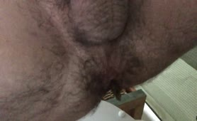 Hairy guy shitting in close up