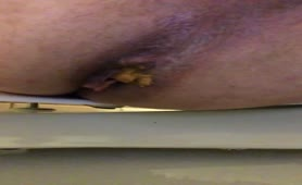 Creamy shit dropped in toilet