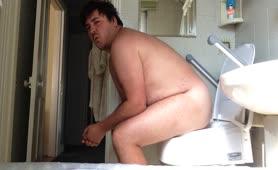Nerd guy shitting in toilet