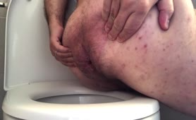 Hairy guy shitting in toilet