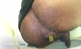 Black guy shitting over toilet